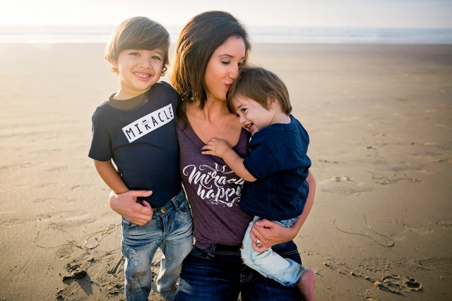 Nadine with her 2 sons on the beach