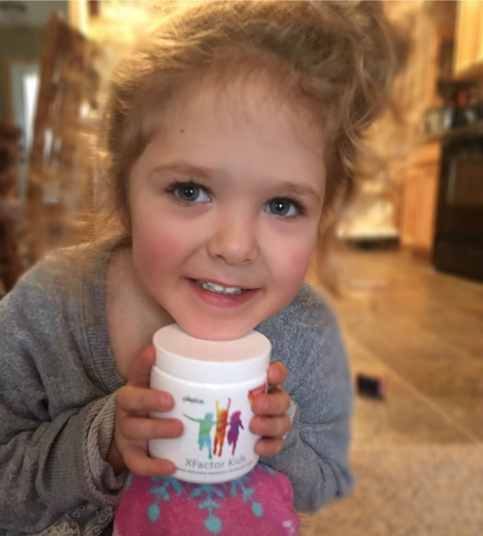 Ava holding a plexus bottle