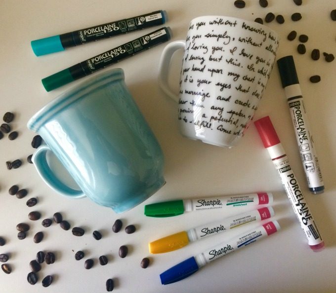 Mugs laying on a table with sharpies