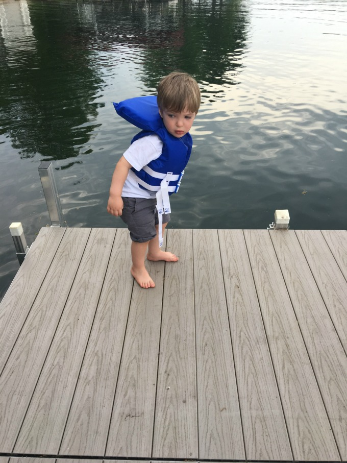 Eli standing on a dock
