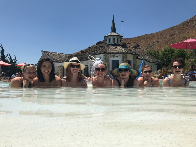 Picture of Caitlin with her friends in the pool