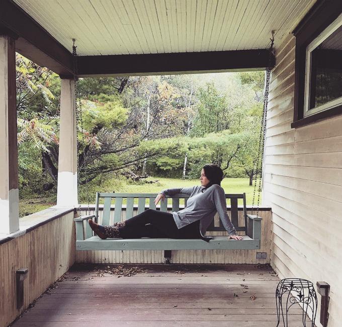 Lynnaya on porch swing