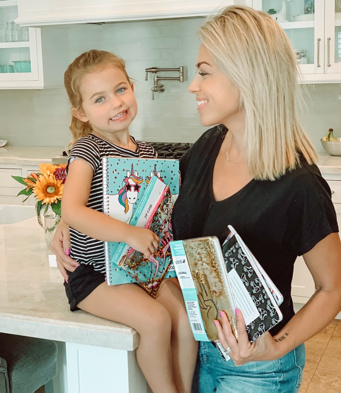 Jessica and Sophie with school supplies