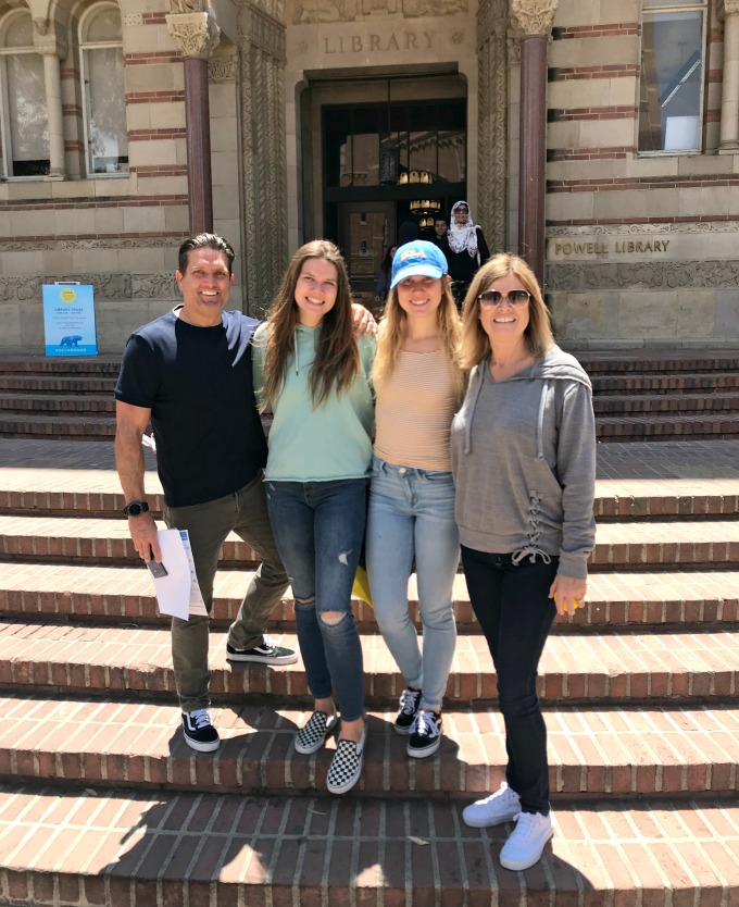 family standing on college library steps