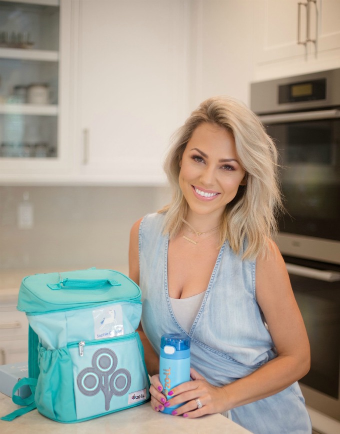 Jessica Hall in the kitchen with a lunchbox