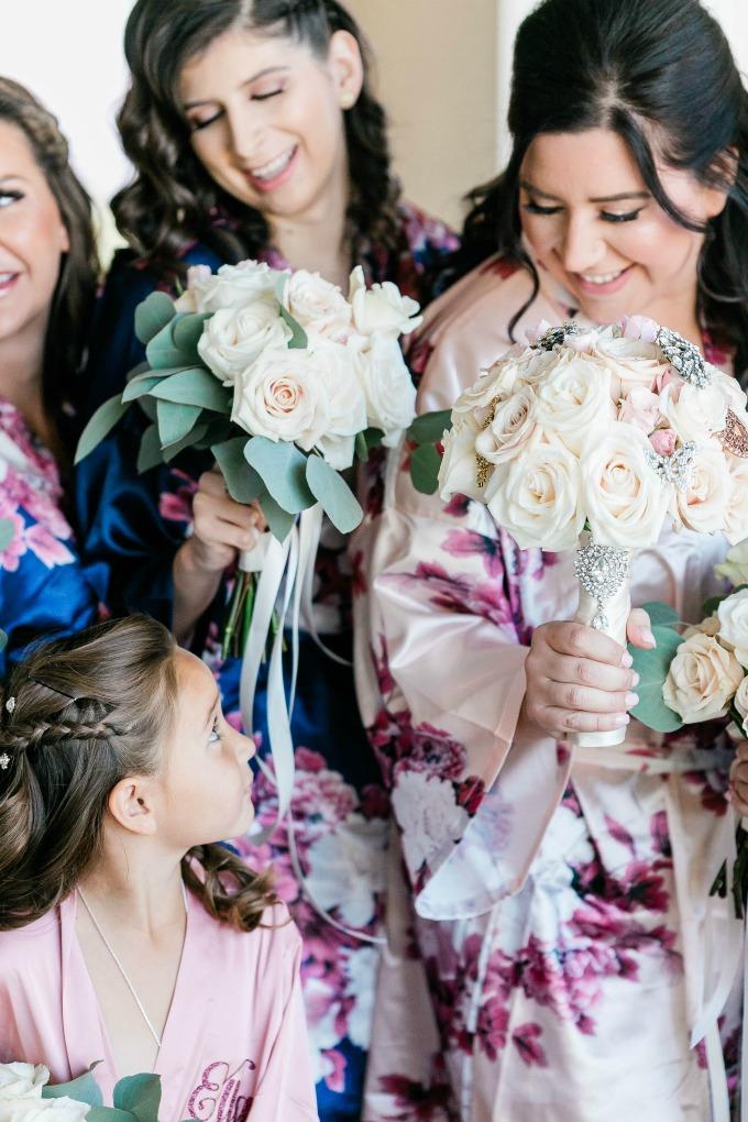bride looking at flower girl