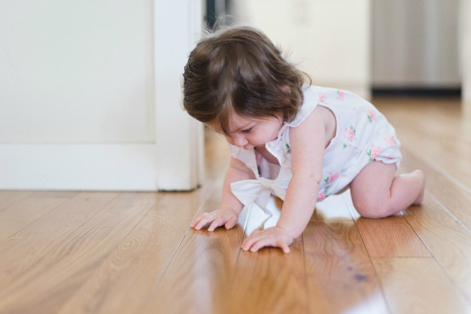baby crawling on hard wood floor