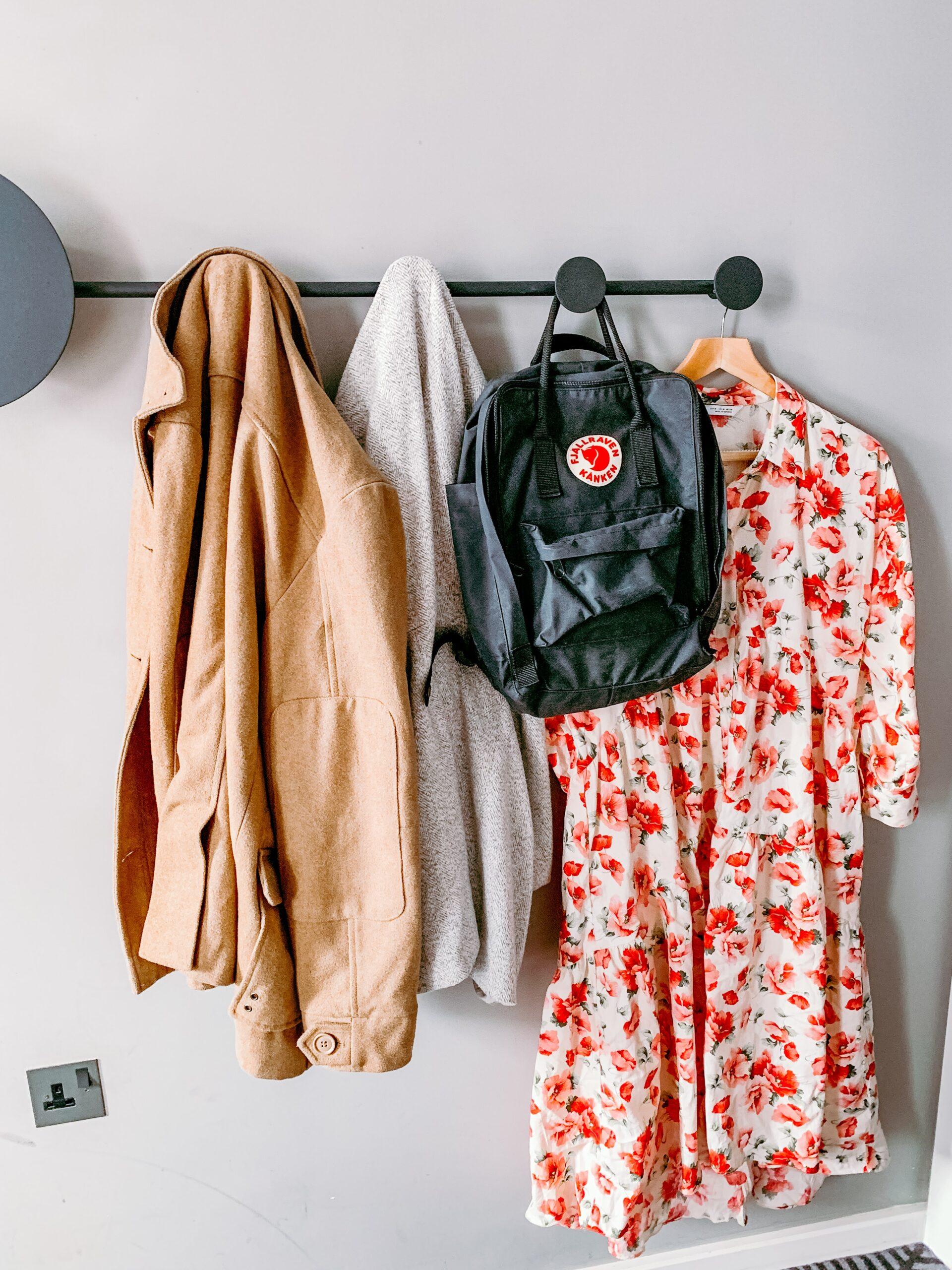 coats and backpack on hooks