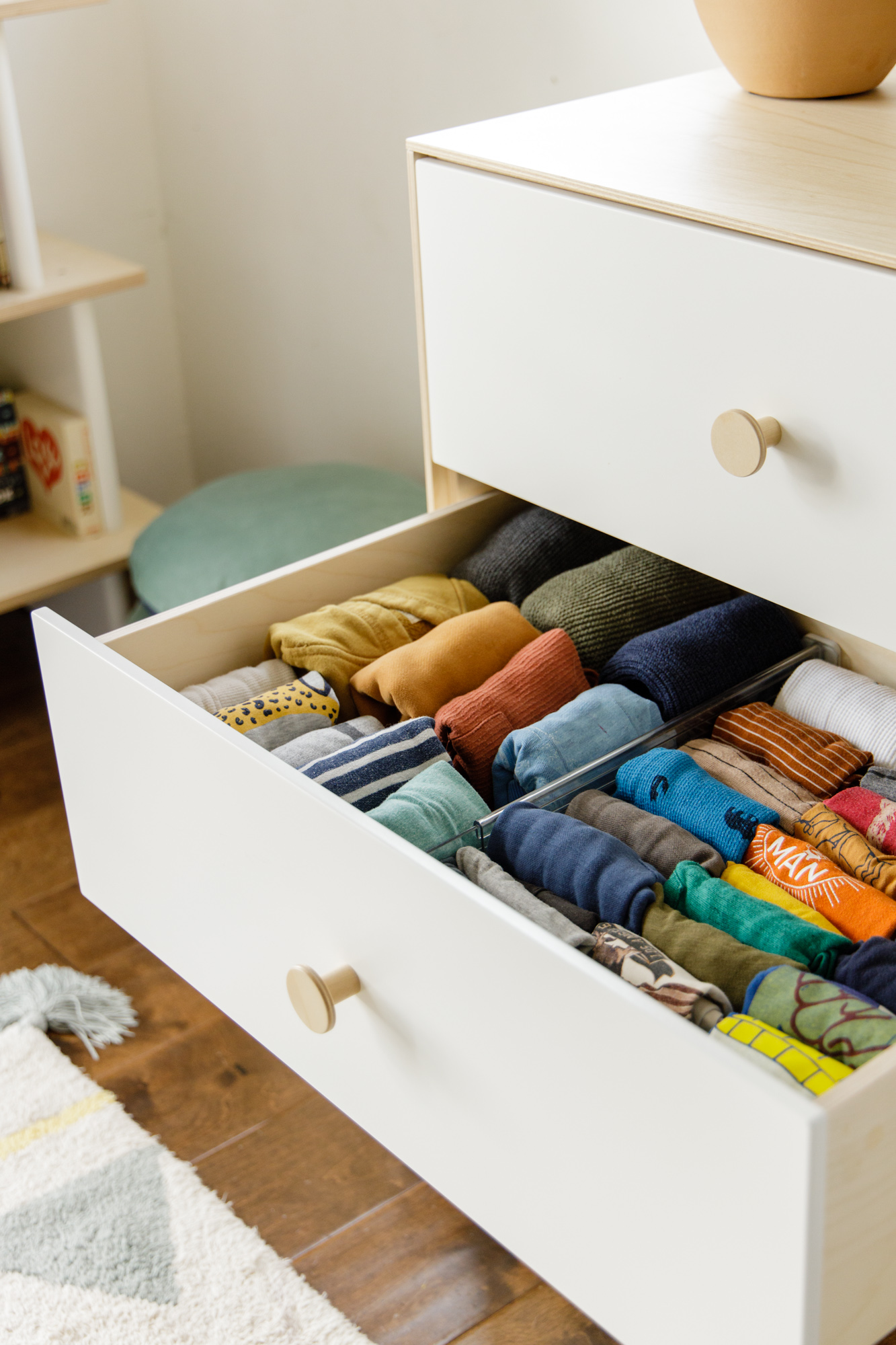 Clothes folded neatly in drawers