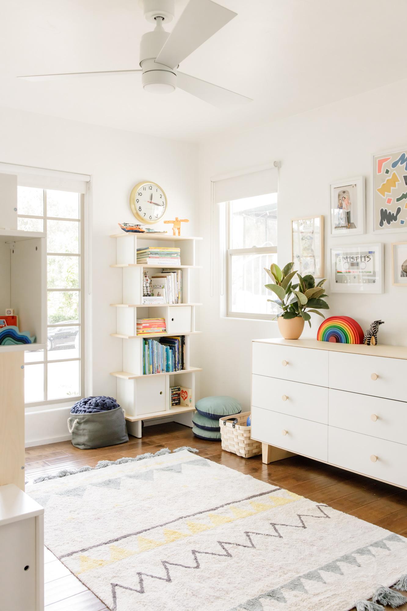 bedroom with dresser and bookshelf
