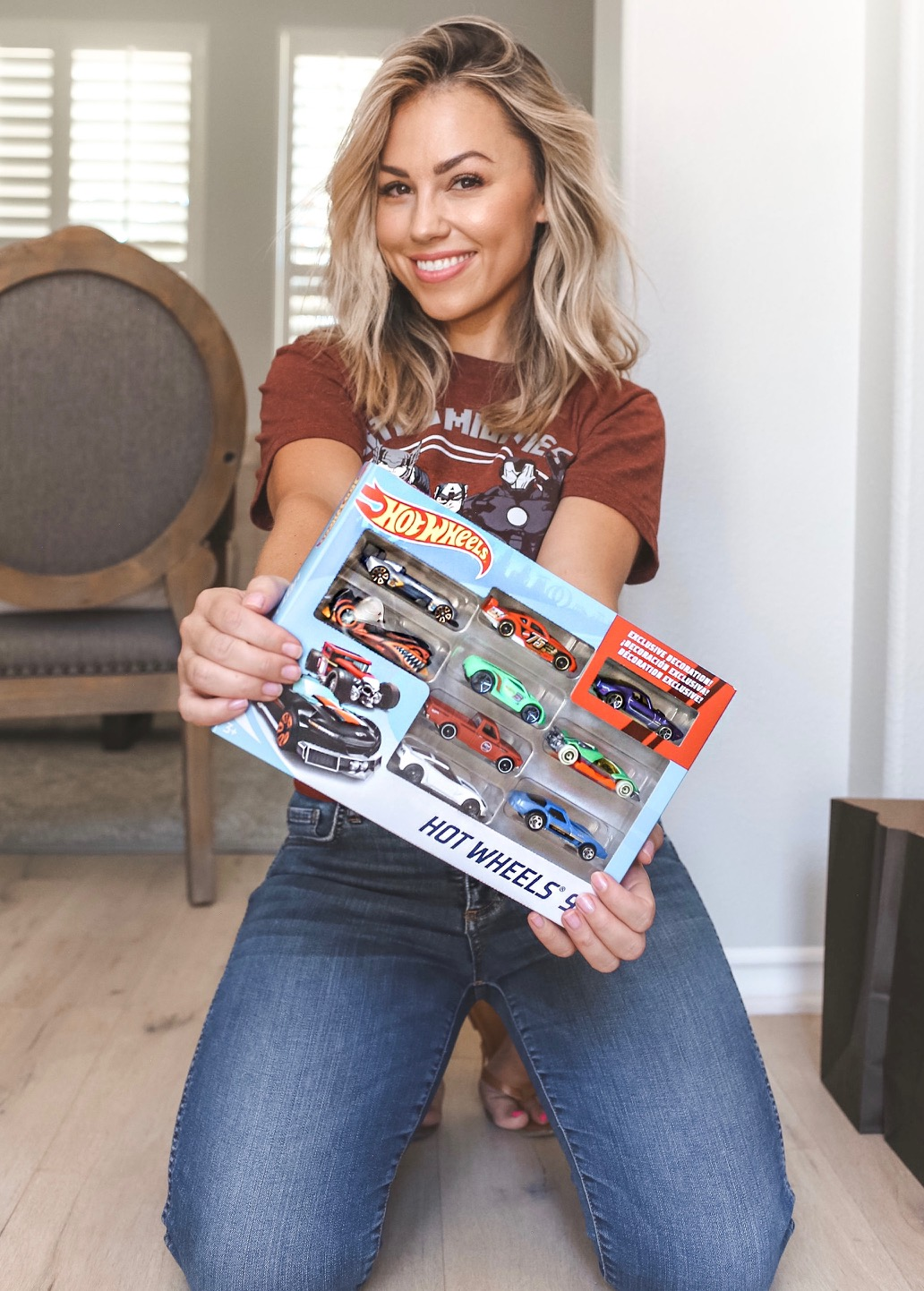 Jessica with Hot Wheels cars