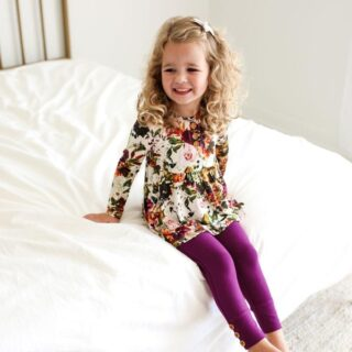 little girl wearing outfit from posh peanut