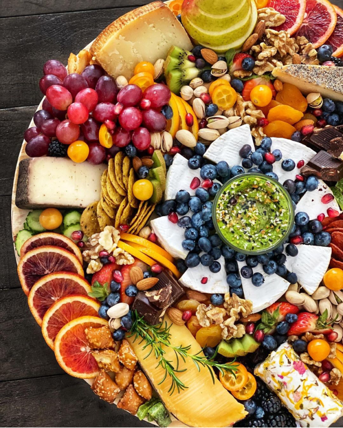 round cheese board with fruits