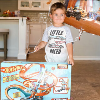 Jake with Hot Wheels track and shirt