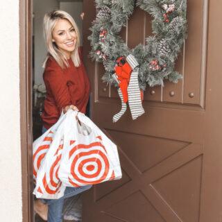 Jessica standing at front door with Target bags