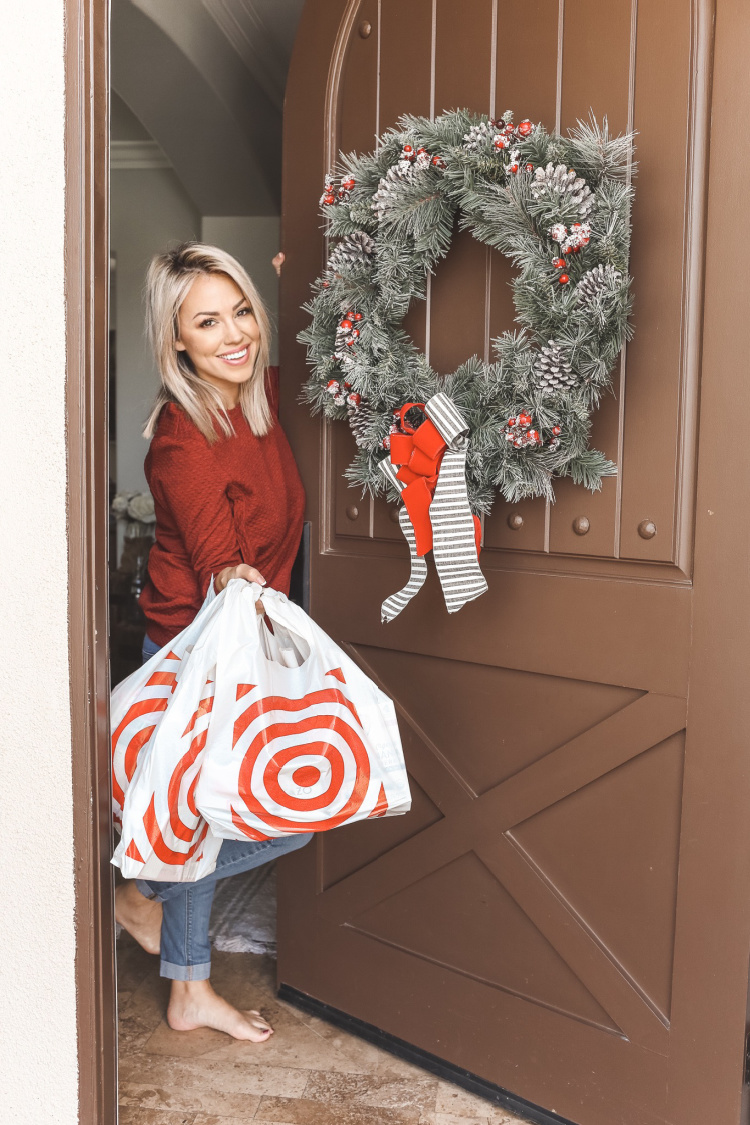 Jessica Hall standing at front door with Target bags