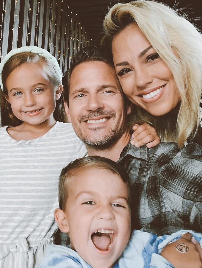 Jessica Hall with her husband, daughter, and son dressed in fall clothes.